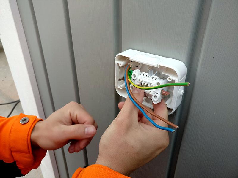 Electrician installing socket